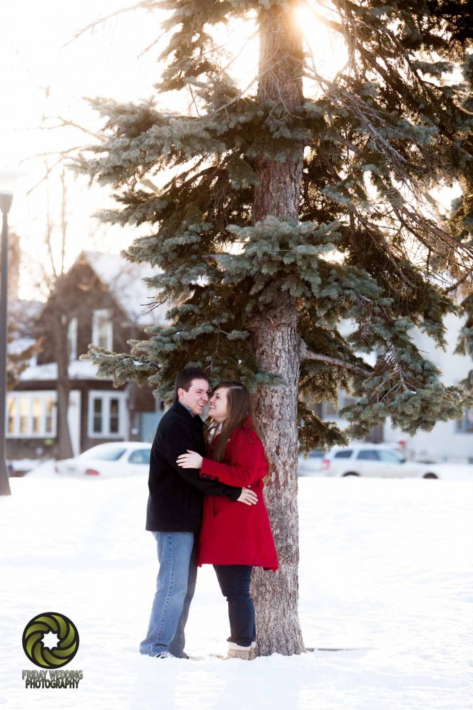 snowy winter engagement pictures against pine tree in bloomington minnesota (2)